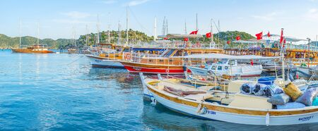 KEKOVA, TURKEY - MAY 7, 2017: The port of Kekova has a mix of big tourist yachts and small fishing boats, on May 7 in Kekova