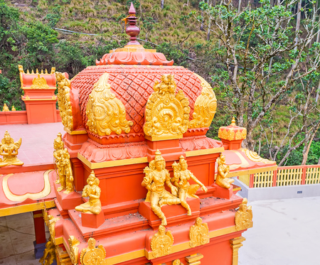 The golden sculptures of Hindu deities decorate red vimana tower of Seetha Amman Temple, located in Seetha Eliya village, Nuwara Eliya, Sri Lanka. Stock Photo