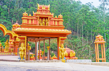 The entrance gate to the Seetha Amman Temple, decorated with golden sculptures and patterns in traditional style, Nuwara Eliya, Sri Lanka. Stock Photo
