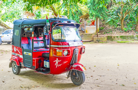 UDUNUWARA, SRI LANKA - NOVEMBER 29, 2016: Tuk tuk taxies are perfect choice to travel to the villages of Kandy district, on November 29 in Udunuwara.