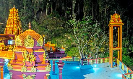 Panorama of Seetha Eliya Hindu Temple in the evening, the temles towers are illuminated with colored lights, Nuwara Eliya, Sri Lanka.