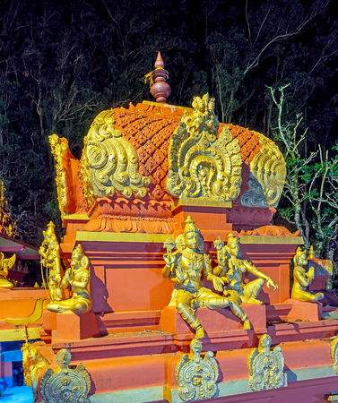 The scenic vimana tower of Seetha Amman Temple with numerous sculptures of Hindu deities in bright evening lights, Nuwara Eliya, Sri Lanka.
