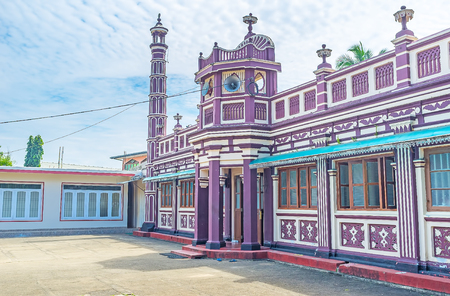 kandy: The Mosque of Al Manar College, one of the oldest Islamic schools in Sri Lanka, the building is decorated with colorful patterns and has minarets from both sides, Handessa, Sri Lanka. Stock Photo