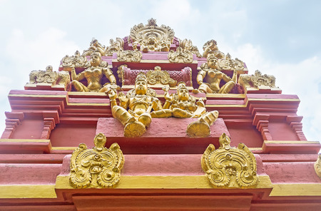 The traditional decoration of Seetha Amman Temple includes sculptures of Hindu deities, relief, complex patterns and bright colors, Nuwara Eliya, Sri Lanka. Stock Photo