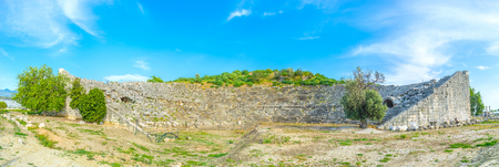sidewall: The panoramic view on ruined amphitheater of ancient Letoon, Turkey