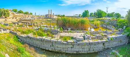 Panoramic view on flooded foundation of ancient temples in ancient Letoon city, Turkey. Stock Photo
