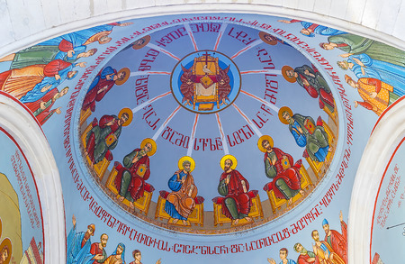 TBILISI, GEORGIA - JUNE 2, 2016: The dome of Georgian Orthodox Kashveti Church of St George decorated with colorful murals on blue background, on June 2 in Tbilisi.