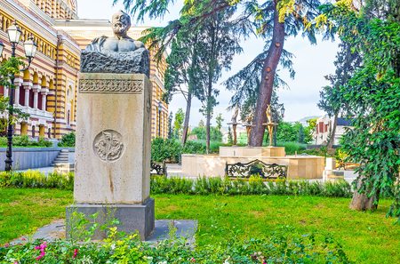The scenic garden of Opera Theater in Tbilisi decorated with the sculpture of Georgian poet Akaki Tsereteli and the scenic fountain with ballerinas on background, Georgia.