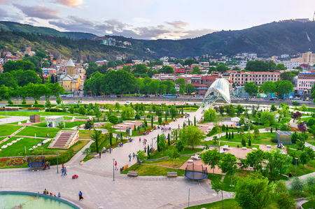 TBILISI, GEORGIA - JUNE 2, 2016: The Rike park is the central recreational area in old town, located on the bank of Kura river and neighboring with the modern Peace bridge, on June 2 in Tbilisi. Stock Photo