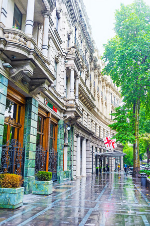 TBILISI, GEORGIA - JUNE 2, 2016: The rainy day in city, Rustaveli Avenue with the shiny wet floor and scenic edifices, on June 2 in Tbilisi. Editorial