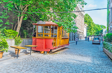 TBILISI, GEORGIA - JUNE 5, 2016: The old tram konka (horsecar), converted into the bar and located in Sioni street of the Kalaubani (Kala district) in downtown, on June 5 in Tbilisi.