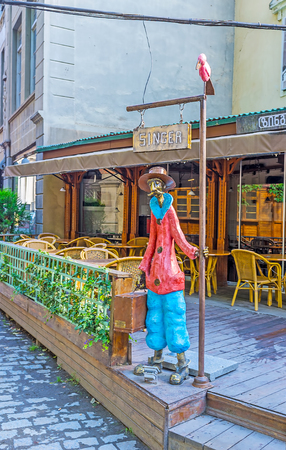 TBILISI, GEORGIA - JUNE 5, 2016: The colorful sculpture of the passenger, waiting forthe konka tram (horsecar) in Sioni street of the Kalaubani (Kala district) in downtown, on June 5 in Tbilisi.