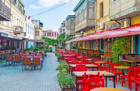 TBILISI, GEORGIA - JUNE 5, 2016: The cozy restaurants and bars along the Erekle II street in Kalaubani (Kala district), the best place to relax and taste the local cuisine with famous Georgian wine, on June 5 in Tbilisi.