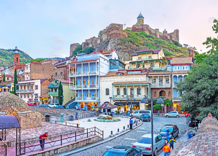 TBILISI, GEORGIA - JUNE 5, 2016: The Sololaki hill, topped with Narikala fortress, is surrounded by the old quarters with scenic edifices and Sulphur baths of Abanotubani district, on June 5 in Tbilisi.