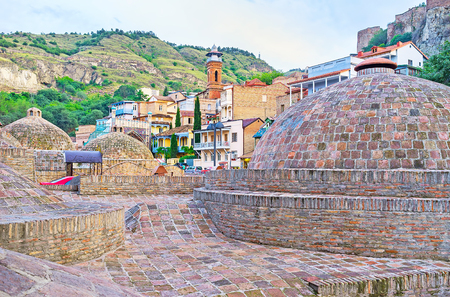 The brick domes of old Sulphur Baths, located in historic Abanotubani neighborhood, at the foot of Narikala fortress, Tbilisi, Georgia.