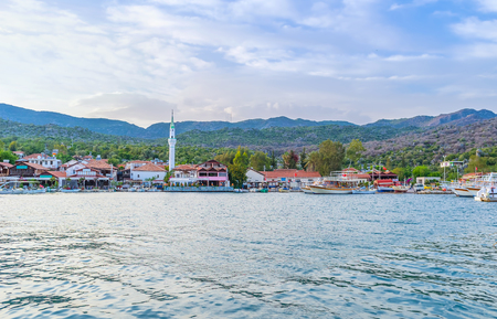 The view on promenade of Kekova with numerous restaurants and bars, from the pier of port, Turkey.