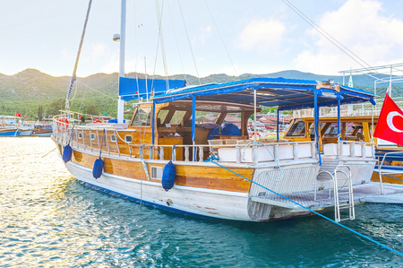 Taking a boat trip is the onle way to discover the underwater ruins of ancient city in Kekova, Turkey