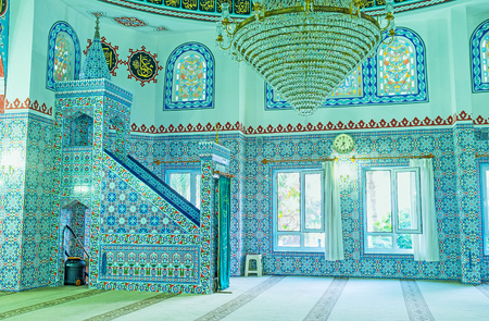 ALANYA, TURKEY - MAY 8, 2017: The walls and minbar of Hasan Senli Saray mosque  covered by glazed tiles with fine islamic patterns, on May 8 in Turkey.