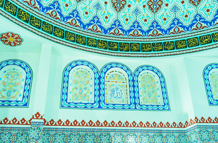 ALANYA, TURKEY - MAY 8, 2017: The small stained glass windows in Hasan Senli Saray mosque decorated with floral patterns and arabic calligraphy, on May 8 in Turkey.