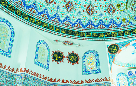 ALANYA, TURKEY - MAY 8, 2017: The prayer hall of Hasan Senli Saray mosque is the perfect place to discover islamic patterns, arabic calligraphy and old stained glass windows, on May 8 in Turkey.