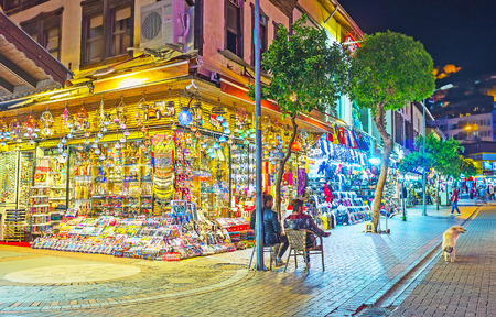 ALANYA, TURKEY - MAY 8, 2017: The toy store in Grand Bazaar with large showcase, full of arabian lights, different toys and souvenirs, on May 8 in Turkey.