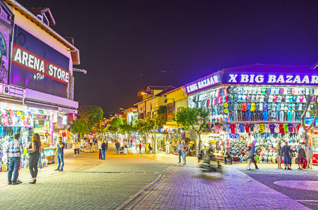 ALANYA, TURKEY - MAY 8, 2017: The tourists often visit Grand Bazaar in the evening, all local stores and cafes are open till late night, on May 8 in Turkey.