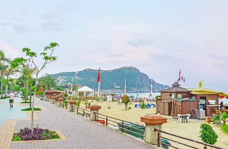 ALANYA, TURKEY - MAY 9, 2017: The pleasant morning in resort - Kleopatra beach is completely empty and the seaside promenade is full of flower fragrances and fresh breeze, on May 9 in Alanya