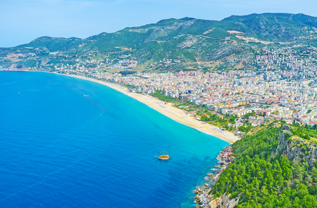 city park boat house: Aerial view of Kleopatra beach from the Castle hill of Alanya, located on peninsula and overlooking the city, Turkey.