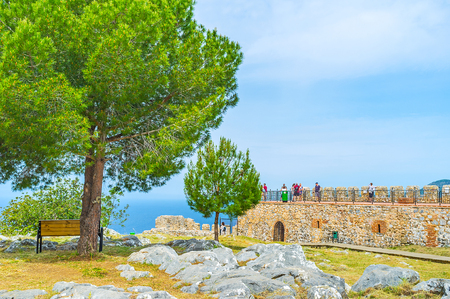 seljuk: ALANYA, TURKEY - MAY 9, 2017: The old Castle, located on the hilltop on Alanya peninsula is the most popular landmark of resort, on May 9 in Alanya. Editorial