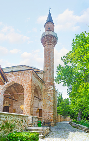 ic: The brick minaret  and tall arches of Suleymaniye Cami (Castle Mosque), located next to the Ic Kale on Castle hill of Alanya, Turkey. Stock Photo