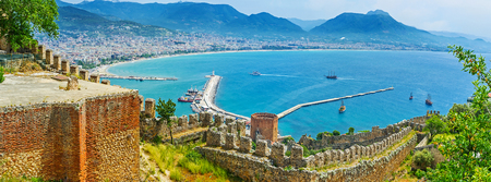 The medieval fortress of Alanya is one of the most interesting local landmarks with open air museum in Ic Kale, Red Tower, old shipyard, preserved gates and picturesque views, Turkey.