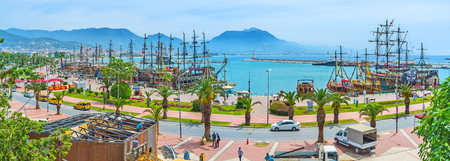 ALANYA, TURKEY - MAY 9, 2017: Panorama of Rihtim Cadessi in old marina, full of pirate galleons for tourist trips, on May 9 in Alanya.