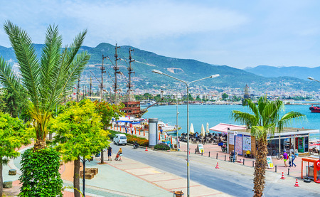 ALANYA, TURKEY - MAY 9, 2017: The old port is the perfect place for the walk, enjoy the boats and tourist ships, take a trip along the coast, on May 9 in Alanya.