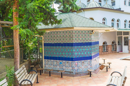 The ablution fountain of Hasan Senli Saray Mosque decorated with the glazed tiles, covered by islamic patterns, Alanya, Turkey.