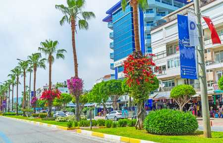 ALANYA, TURKEY - MAY 9, 2017: The Ataturk Boulevard is the central street of resort, here locates central hotels, big stores, luxury restaurants, it decorated with the scenic plants and bright flowers, on May 9 in Alanya. Editorial
