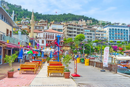 ALANYA, TURKEY - MAY 9, 2017: The summer terraces of popular fish restaurants, located on the shore of old marina, on May 9 in Alanya. Editorial