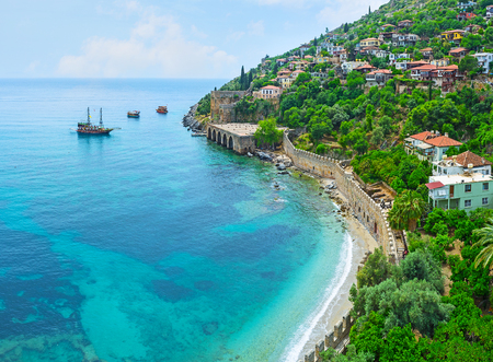 The rocky coast of Alanya peninsula is defended with the medieval fortress wall, Turkey.