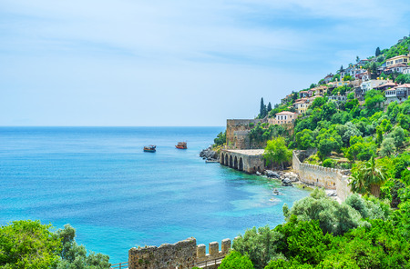 The coast of Alanya peninsula with preserved ramparts of the medieval fortress, Turkey.