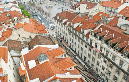 LISBON, PORTUGAL - MAY 2, 2012: The scenic patterns on Portuguese pavement in Aurea street are perfectly seen from the viewpoint of Carmo Lift, on May 2 in Lisbon.