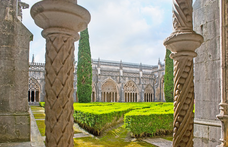 BATALHA, PORTUGAL - APRIL 30, 2012: The  carved pillars with different patterns decorate the Royal Cloister of King John I in Convent of St Mary of Victory, on April 30 in Batalha.