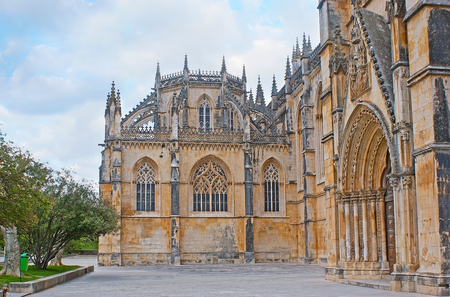 Exterior of Batalha Monastery of Santa Maria da Vitoria, the view on tower of Unfisnished Chapel, Portugal. Stock Photo