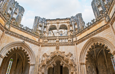 BATALHA, PORTUGAL - APRIL 30, 2012: The complex details of the Unfinished Chapels in St Mary of Victory Convent, limestone carved patterns are masterpieces of Gothic style, on April 30 in Batalha. Editorial