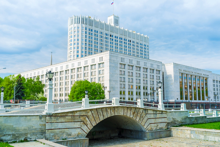 MOSCOW, RUSSIA - MAY 11, 2015: The small humpbacked bridge over non-existent riverbed Presnya, located next to the Government building, on May 11 in Moscow, Russia