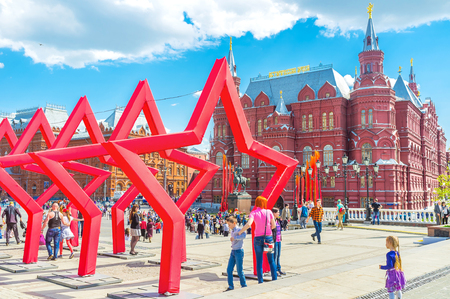 MOSCOW, RUSSIA - MAY 11, 2015: Installation of big red Victory Stars on Manezhnaya Square during celebration Victory Day, on May 11 in Moscow