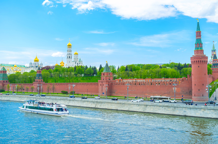 MOSCOW, RUSSIA - MAY 11, 2015: The huge size of Moscow Kremlin is best seen from other side of Moskva river, on May 11 in Moscow