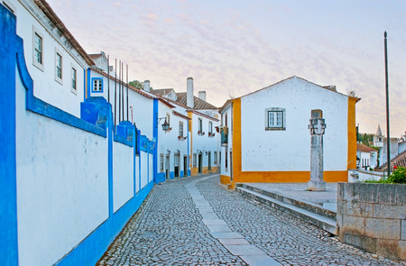 Rua Direita is the central street of medieval Obidos, here, next to the town gate locates the preserved pillory, Portugal.