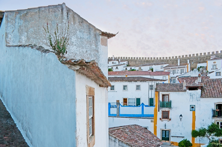 The cityscape of Obidos, house corner is built to the fortress wall, Portugal.