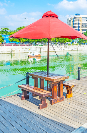 The Pettah Floating Market on Beira lake offers interesting shopping, trips on catamarans or boats and cozy cafes and bars to relax at the lake, Colombo, Sri Lanka.