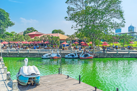 COLOMBO, SRI LANKA - DECEMBER 7, 2016:  The Pettah Floating Market is interesting tourist location and the perfect place to relax, make a boat trip, visit local cafe or walk along the banks of Beira lake, on December 7 in Colombo. Editorial