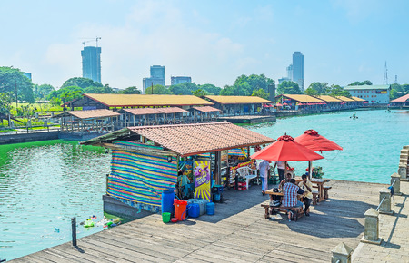 COLOMBO, SRI LANKA - DECEMBER 7, 2016:  The small outdoor cafe at Pettah Floating Market on the bank of Beira lake is the perfect place to relax, on December 7 in Colombo.